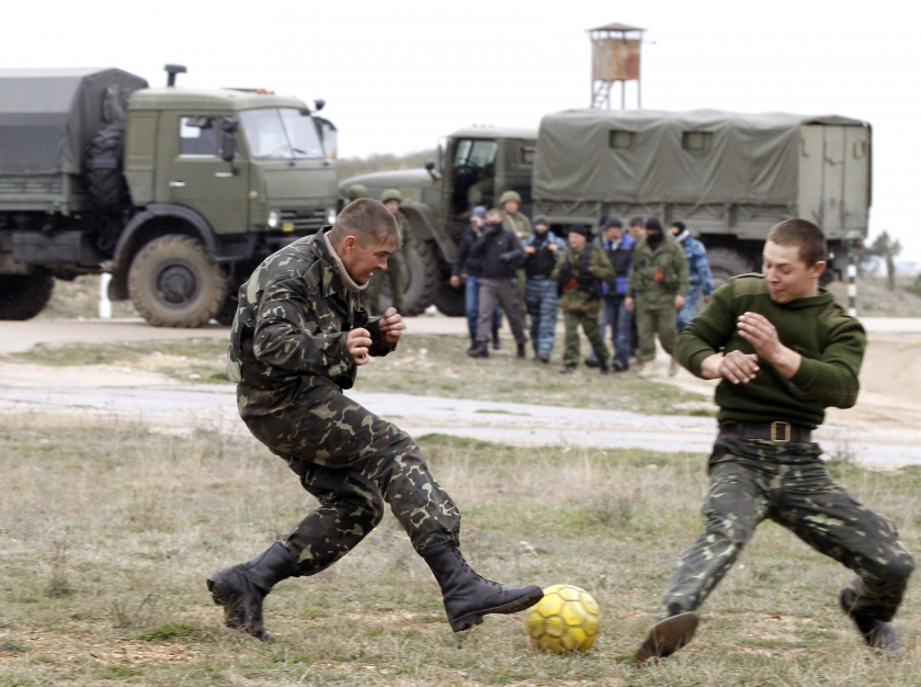 Ukrainian servicemen play football near Russian military vehicles at the Belbek Sevastopol International Airport (Photo: Reuters)