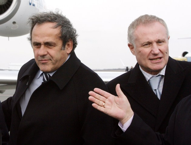 UEFA President French Michel Platini (L) and Ukrainian Football Federation President Grigory Surkis inspect Donetsk airport on April 7, 2010. Platini will be accompanied by UEFA vice-president Marios N. Lefkaritis and senior UEFA administration members on the trip to the four host cities in Ukraine: Donetsk, Kharkiv, Kiev and Lviv. AFP PHOTO/ ALEXANDER KHUDOTEPLY