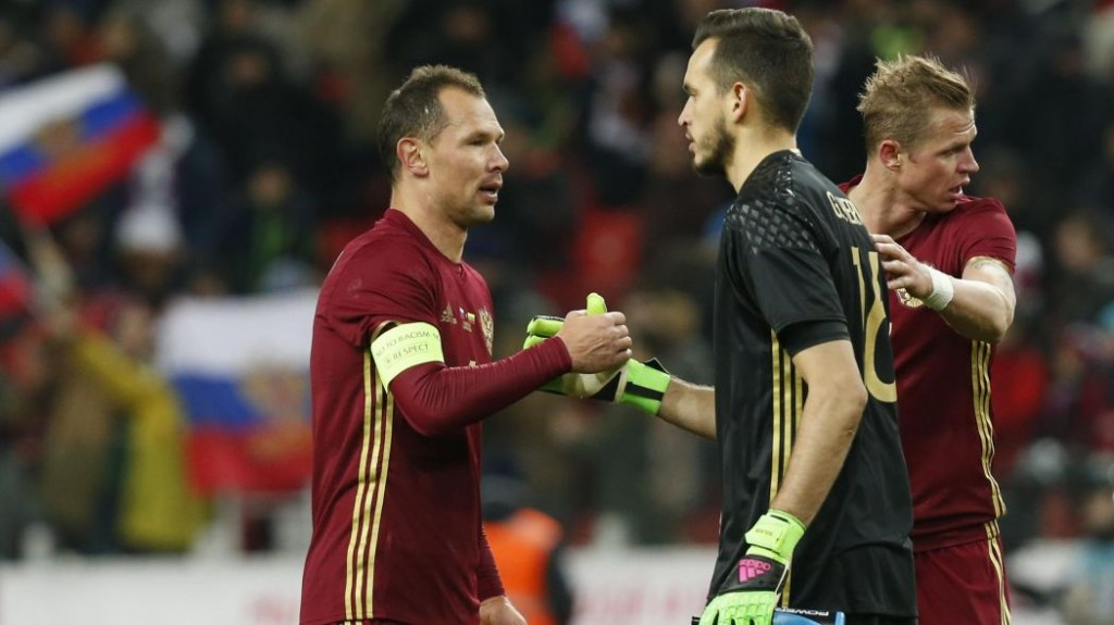 Guilherme being congratulated by his Russia teammates after making his debut against Lithuania - Image via Eurosport