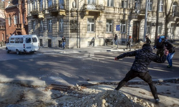 Members of far-right groups throw stones during a protest against the LGBT community in Lviv - Image via Guardian