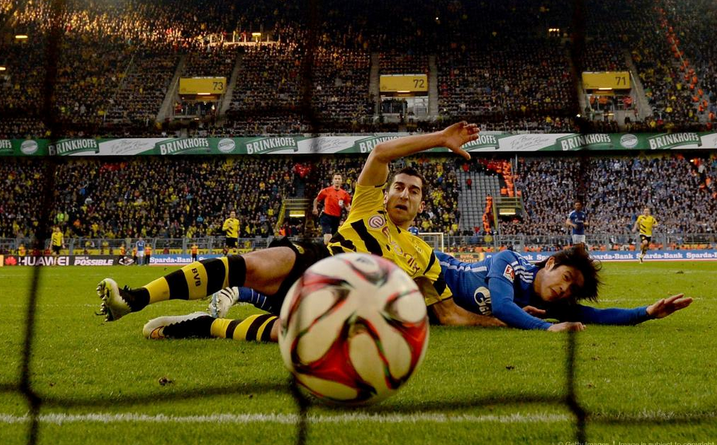 Mkhitaryan wrote history last season by scoring during the Schalke 04 vs Borussia Dortmund derby -- Image via abc