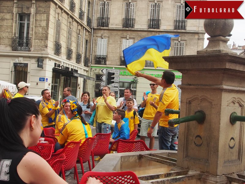 Ukrainian fans gather at a bar prior to the match