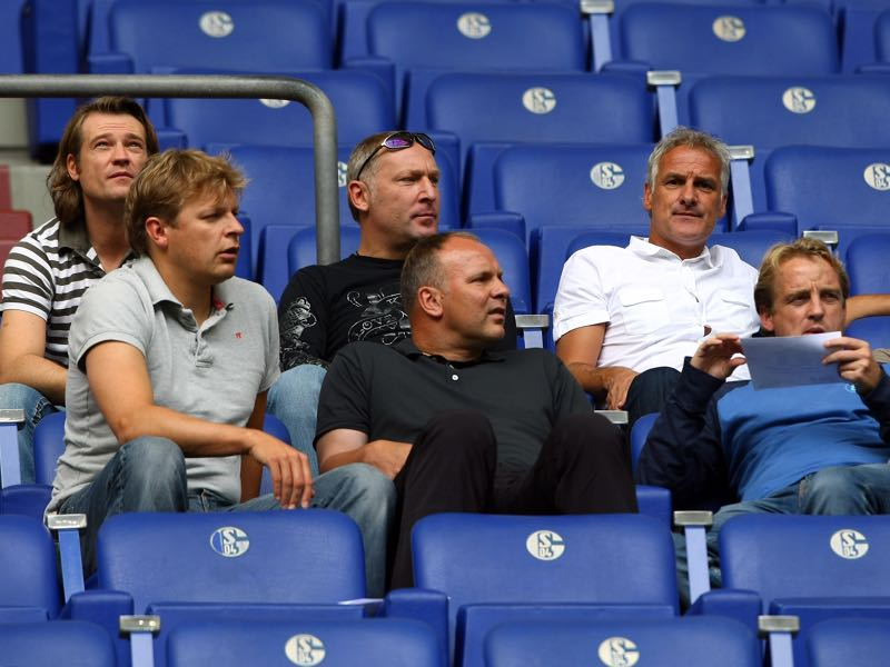 ssitant team manager Erik Stoffelshaus, manager Andreas Mueller, head coach Fred Rutten, assistant coach Youri Mulder, goalkeeper coach Oliver Reck and assistant coach Mike Bueskens watch the Regionalliga match between Schalke 04 II and Preussen Muenster at the Veltins Arena on August 17, 2008 in Gelsenkirchen, Germany. (Photo by Christof Koepsel/Bongarts/Getty Images for DFB)