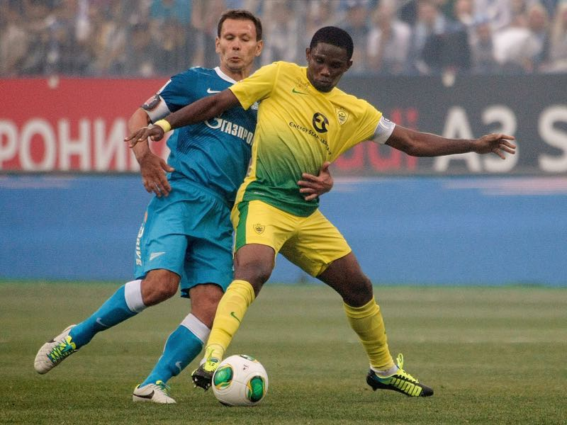 Konstantin Zyryanov of FC Zenit St. Petersburg (L) and Samuel Eto'o of FC Anji Makhachkala vie for the ball during the Russian Premier League match between FC Zenit St. Petersburg and FC Anzhi Makhachkala at the Petrovsky stadium on August 17, 2013 in St. Petersburg, Russia. (Photo by Epsilon/Getty Images)