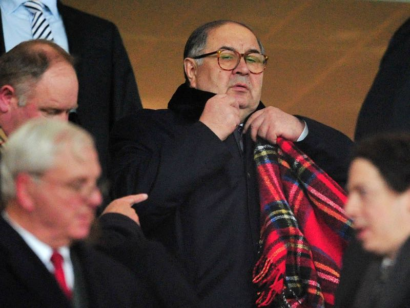 Arsenal shareholder Alisher Usmanov (C) attends the UEFA Champions League Last 16, first leg football match between Arsenal and Bayern Munich at The Emirates Stadium in north London on February 19, 2014. AFP PHOTO / GLYN KIRK (Photo credit should read GLYN KIRK/AFP/Getty Images)