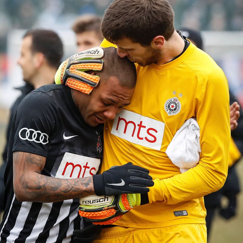 Partizan Belgrade's goalkeeper Filip Kljajic (R) hugs Brazilian midfielder Everton Luiz as he leaves the field in tears (STR/AFP/Getty Images)