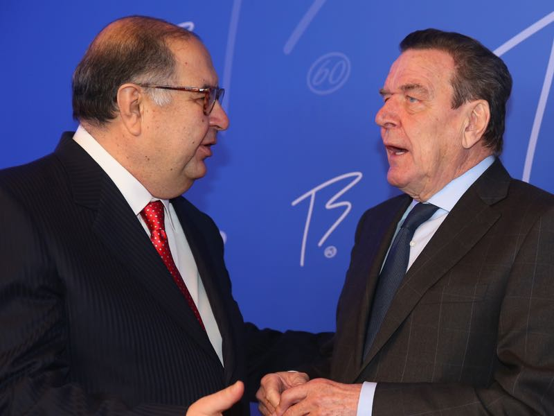 Former German Chancellor Gerhard Schroeder talks to Alisher Usmanov (L), President of the International Fencing Federation during the IOC President Thomas Bach's 60th Birthday party at Stadthalle on January 10, 2014 in Tauberbischofsheim, Germany. (Photo by Alexander Hassenstein/Bongarts/Getty Images)