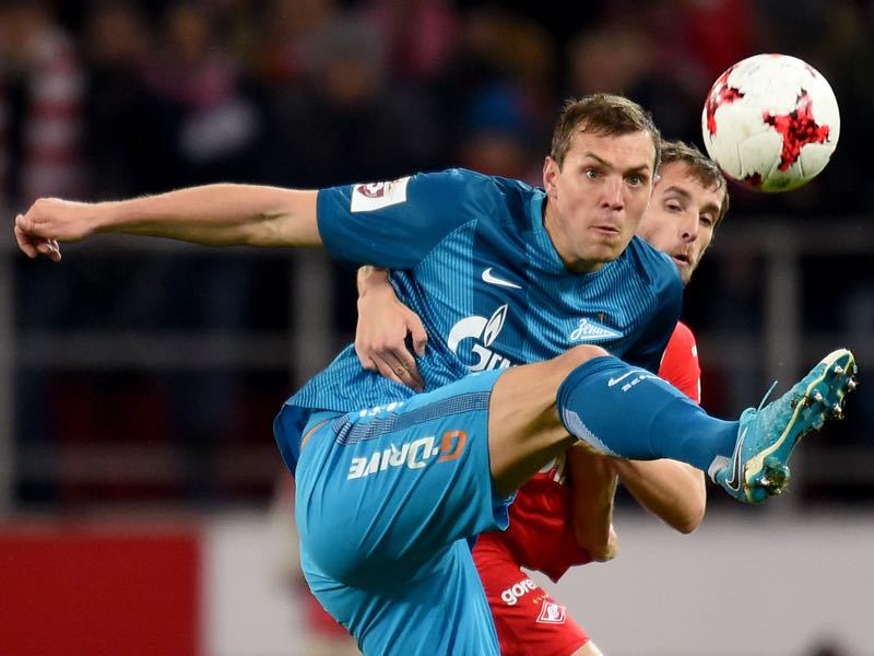 Dmitri Kombarov (R) of FC Spartak Moscow is challenged by Artyom Dzyuba of FC Zenit Saint Petersburg during the Russian Premier League match between FC Spartak Moscow v FC Zenit Saint Petersburg at Otkrytie Arena Stadium on April 16, 2017 in Moscow, Russia. (Photo by Epsilon/Getty Images)
