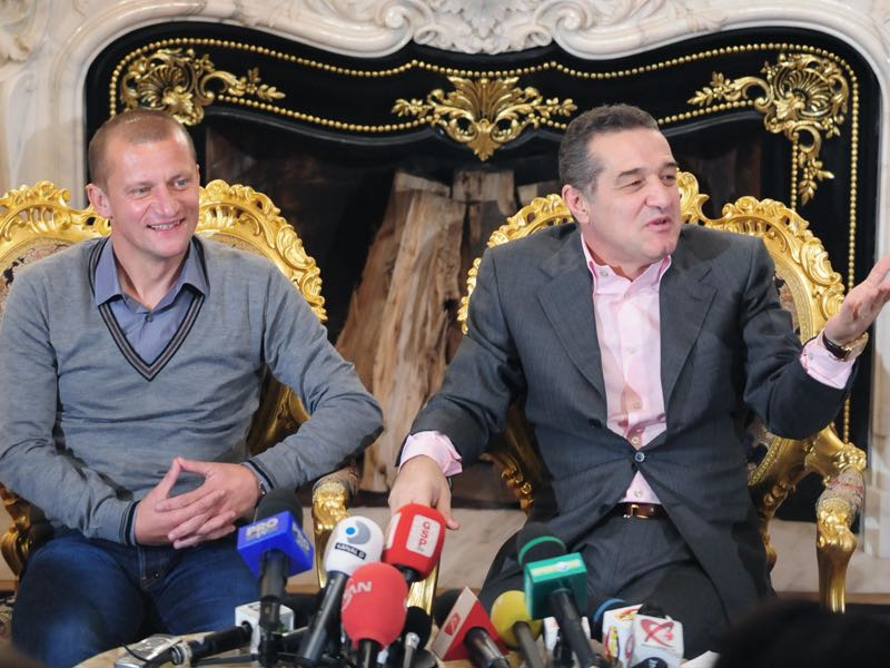 Gigi Becali (r.) has run Steaua Bucharest like his personal fiefdom. (DANIEL MIHAILESCU/AFP/Getty Images)