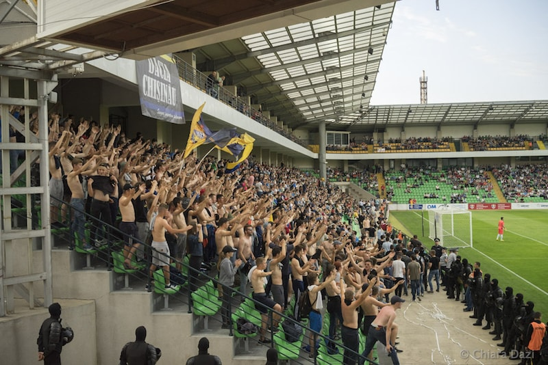 Fans on the main stand of the Zimbru Stadium are eagerly supporting their side. Image by Chiara Dazi