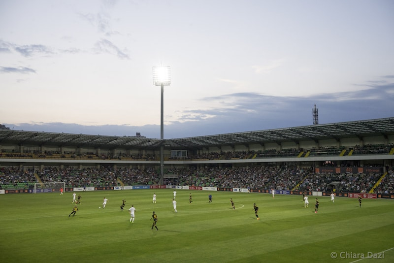 The sun sets over the Zimbru Stadium in Fans on the main stand of the Zimbru Stadium. Image by Chiara Dazi