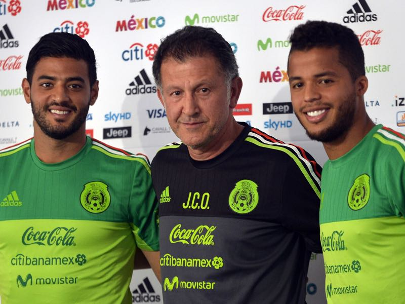 Mexico's national football team players Carlos Vela (L) and Giovani dos Santos (R) and coach Juan Carlos Osorio ahead of the 2017 FIFA Confederations Cup. (PEDRO PARDO/AFP/Getty Images)