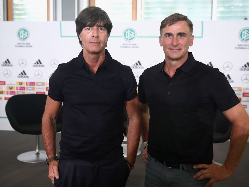Joachim Löw (l.) and Stefan Kuntz announced the Germany squads for the Confederations Cup and U-21 European Championships at a press conference on May 17. (Photo by Alex Grimm/Bongarts/Getty Images)