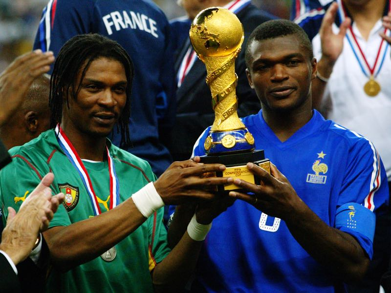 Rigobert Song of Cameroon and Marcel Desailly of France both hold the winning trophy after the 2003 FIFA Confederations Cup Final between France and Cameroon. (Photo by Ben Radford/Getty Images)