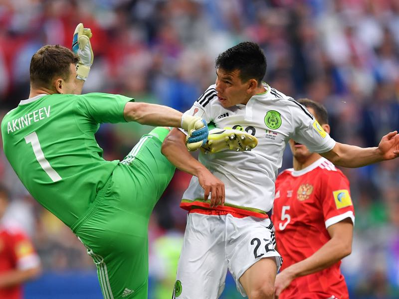 Igor Akinfeev will have to take the blame for misguiding the situation ahead of Mexico's second goal. (YURI CORTEZ/AFP/Getty Images)