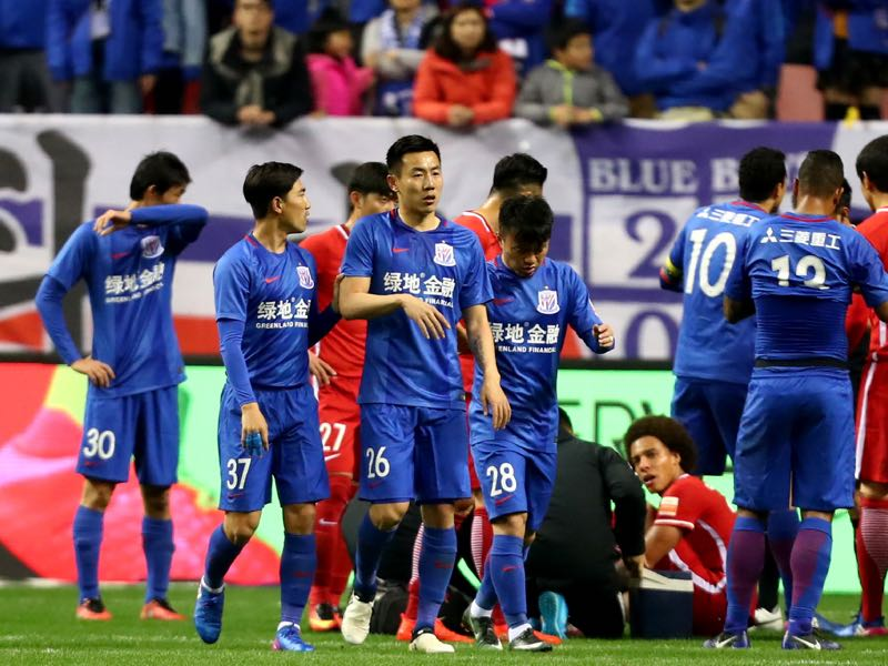 Inflated prices for Chinese national team players should be a warning for Russian lawmakers. (STR/AFP/Getty Images)