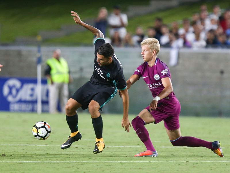 Oleksandr Zinchenko (r.) played the pre-season with Manchester City in the United States. (RINGO CHIU/AFP/Getty Images)