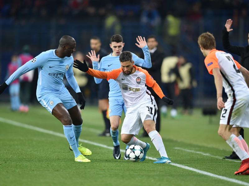 Marlos, here surrounded by a sea of City players, was the man of the match. (GENYA SAVILOV/AFP/Getty Images)