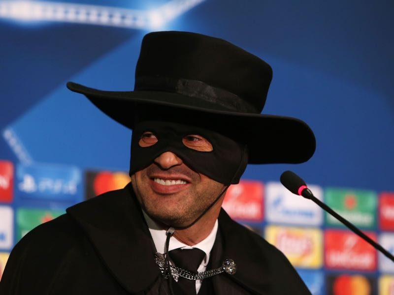 Paulo Fonseca dressed up as Zorro after Shakhtar managed to qualify for the round of 16 of the Champions League with a victory over Manchester City. (STANISLAS VEDMID/AFP/Getty Images)