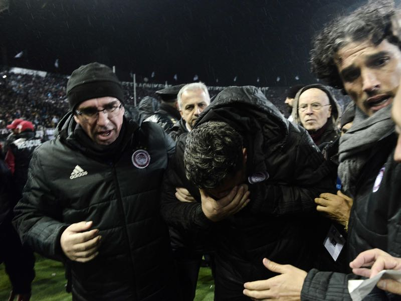 Olympiacos head coach Oscar Garcia after being hit by a paper roll ahead of the Superleague game against PAOK. (SAKIS MITROLIDIS/AFP/Getty Images)