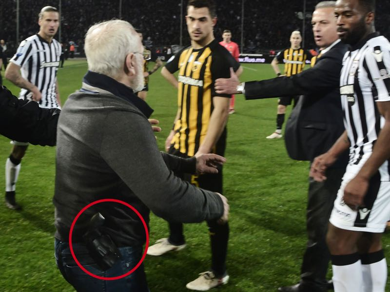 Ivan Savvidis on the pitch with a gun strapped to his waste band. (STRINGER/AFP/Getty Images)