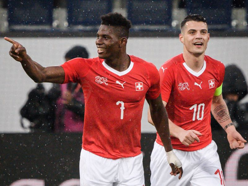 Breel Embolo (l.) and Granit Xhaka (r.) will be two players to watch in Group E (FABRICE COFFRINI/AFP/Getty Images)
