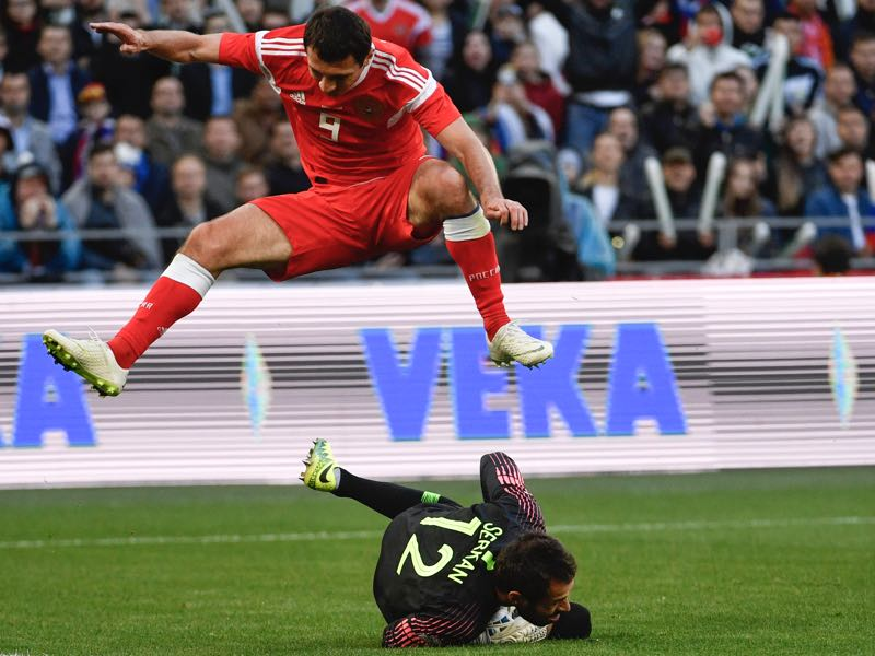 Alan Dzagoev (jumping) will be Russia's key player according to our analysis Calamity Akinfeev will remain the number one keeper for Russia (ALEXANDER NEMENOV/AFP/Getty Images)