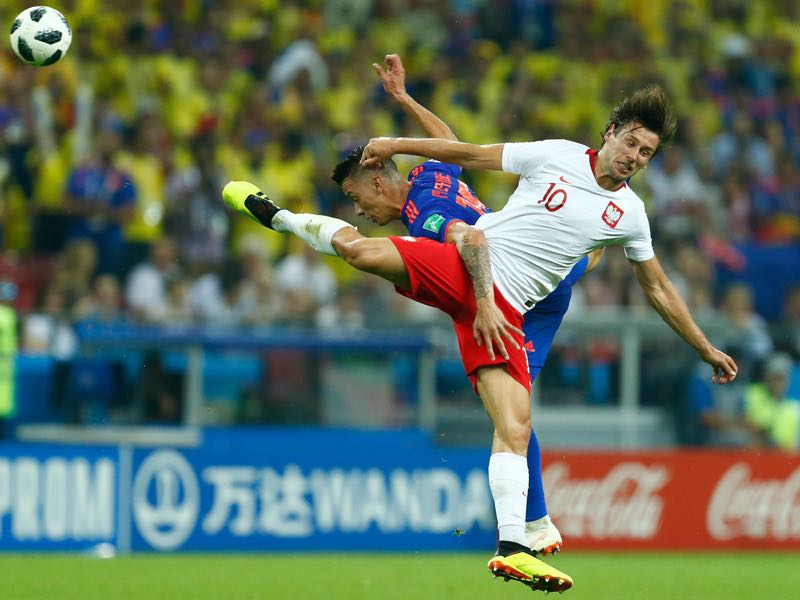 Grzegorz Krychowiak (R) and Poland struggled at the World Cup in Russia (BENJAMIN CREMEL/AFP/Getty Images)