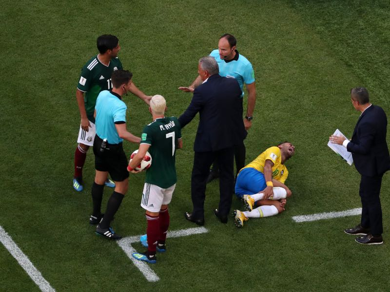 Neymar Jr of Brazil goes down injured during the 2018 FIFA World Cup Russia Round of 16 match between Brazil and Mexico at Samara Arena on July 2, 2018 in Samara, Russia. (Photo by Clive Rose/Getty Images)