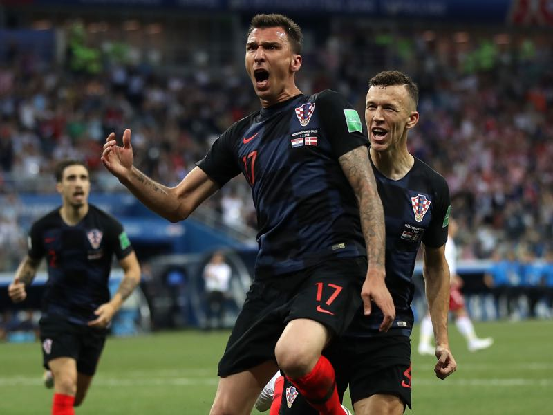 Mario Mandzukic of Croatia celebrates after scoring his team's first goal during the 2018 FIFA World Cup Russia Round of 16 match between Croatia and Denmark at Nizhny Novgorod Stadium on July 1, 2018 in Nizhny Novgorod, Russia. (Photo by Julian Finney/Getty Images)