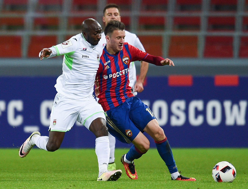 Aleksandr Golovin (R) of PFC CSKA Moscow is challenged by Kehinde Fatai of FC Ufa during the Russian Premier League match between PFC CSKA Moscow and FC Ufa at CSKA Arena Stadium on October 14, 2016 in Moscow, Russia. (Photo by Epsilon/Getty Images)