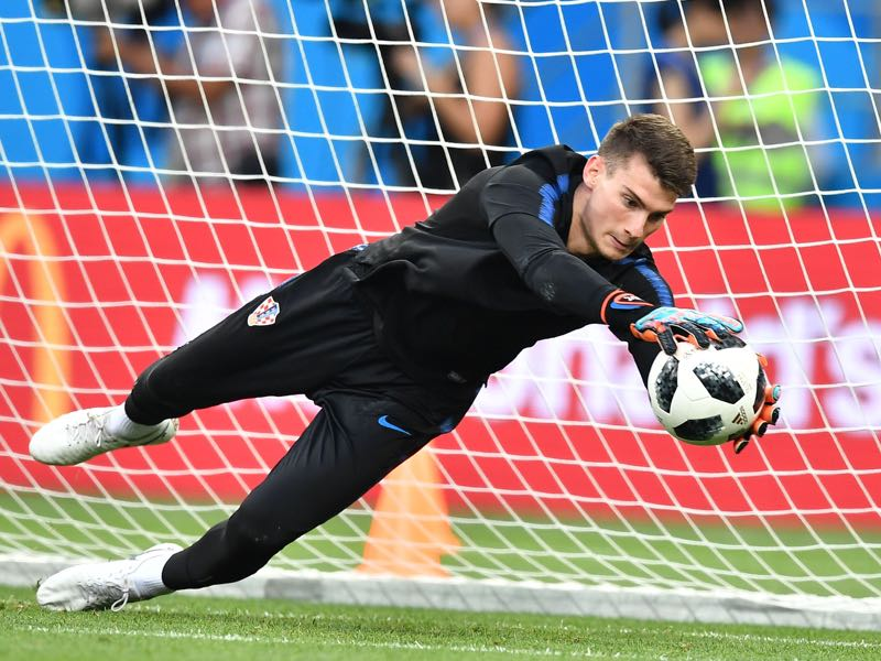 Dominik Livaković jumps to catch it as he takes part in a training session of Croatian national football team at the Rostov Arena, in Rostov-on-Don, on June 25, 2018. (Photo by JOE KLAMAR / AFP)
