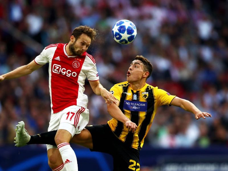 Daley Blind of Ajax wins a header over Ezequiel Ponce of AEK Athens during the Group E match of the UEFA Champions League between Ajax and AEK Athens at Johan Cruyff Arena on September 19, 2018 in Amsterdam, Netherlands. (Photo by Dean Mouhtaropoulos/Getty Images)