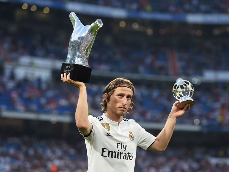Luka Modrić of Real Madrid celebrates with his 2017/18 UEFA Men's Player of the Year award before the La Liga match between Real Madrid CF and CD Leganes. He will be one of the key players for Real Madrid in this Group G (Photo by Denis Doyle/Getty Images)