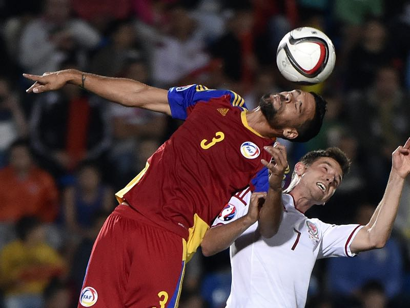 Andorra defender Marc Vales (L) and Wales midfielder Joe Allen go for a header during the Euro 2016 qualifying round football match Andorra vs Wales on September 9, 2014 at the Municipal Stadium in Andorra. AFP PHOTO / PASCAL PAVANI (Photo credit should read PASCAL PAVANI/AFP/Getty Images)