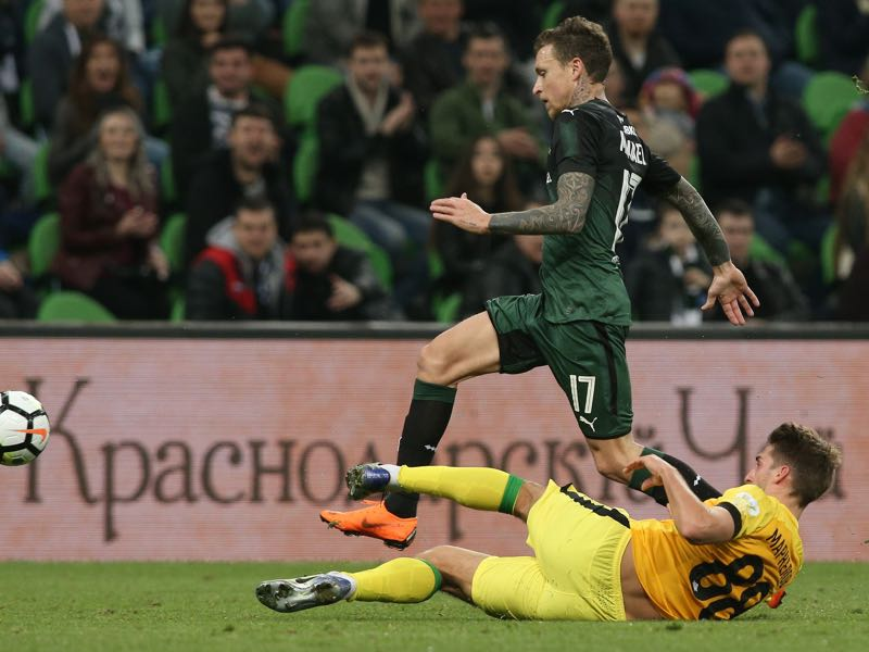 Pavel Mamaev (L) of FC Krasnodar vies for the ball with Ivan Markelov of FC Anzhi Makhachkala during the Russian Premier League match between FC Krasnodar v FC Anzhi Makhachkala at Krasnodar Stadium on April 01, 20018 in Krasnodar, Russia. (Photo by Epsilon/Getty Images)