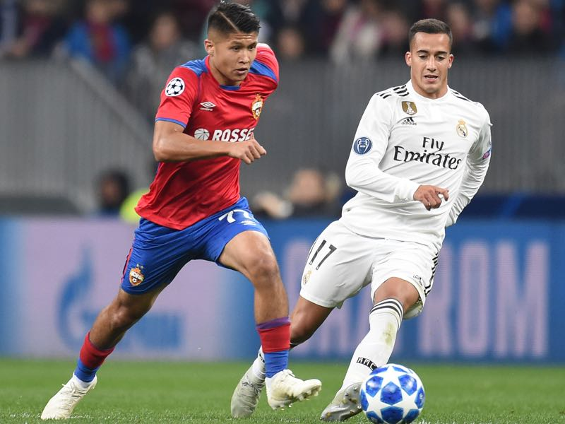 Ilzat Akhmetov (L) of PFC CSKA Moscow is challenged by Lucas Vazquez of Real Madrid during the Group G match of the UEFA Champions League between CSKA Moscow and Real Madrid at the Luzhniki Stadium on October 02, 2018 in Moscow, Russia. (Photo by Epsilon/Getty Images)
