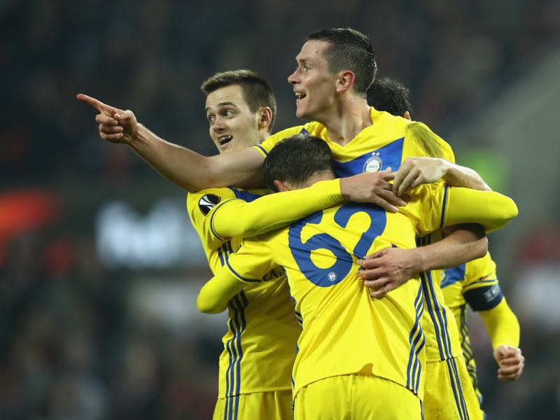 Nikolai Signevich of FC Bate Borisov celebrates with teammates after scoring his sides second goal during the UEFA Europa League group H match between 1. FC Koeln and BATE Borisov at RheinEnergieStadion on November 2, 2017 in Cologne, Germany. (Photo by Maja Hitij/Bongarts/Getty Images)