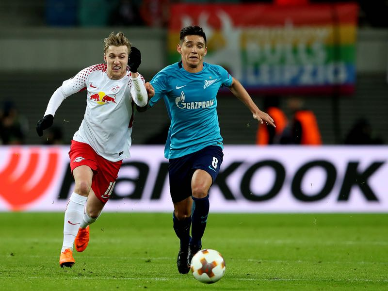 Emil Forsberg (L) of RB Leipzig vies with Matas Kranevitter (R) of FC Zenit Saint Petersburg during the UEFA Europa League Round of 16 match between RB Leipzig and Zenit St Petersburg at the Red Bull Arena on March 8, 2018 in Leipzig, Germany. (Photo by Ronny Hartmann/Bongarts/Getty Images)