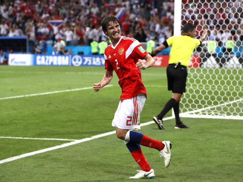 Mario Fernandes of Russia celebrates after scoring his team's second goal during the 2018 FIFA World Cup Russia Quarter Final match between Russia and Croatia at Fisht Stadium on July 7, 2018 in Sochi, Russia. (Photo by Kevin C. Cox/Getty Images)
