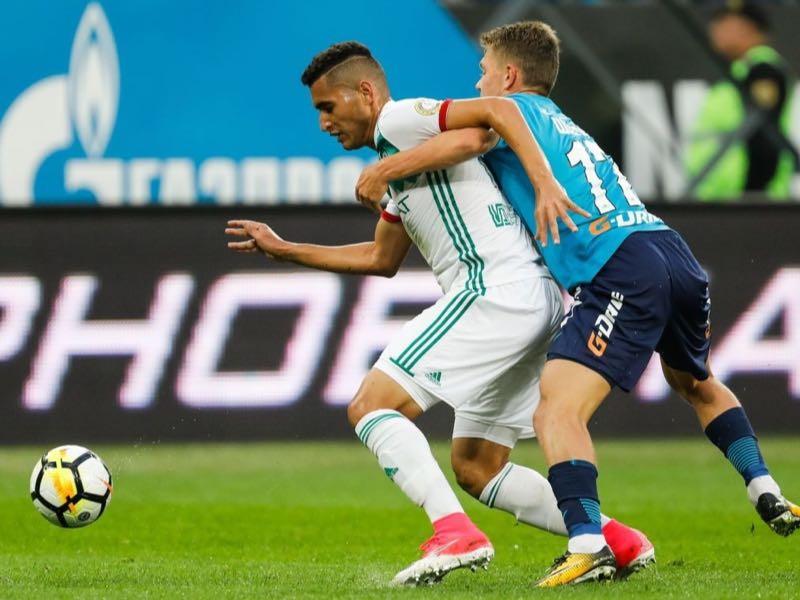 Oleg Shatov (R) of FC Zenit Saint Petersburg and Ravanelli of FC Akhmat Grozny vie for the ball during the Russian Football League match between FC Zenit St. Petersburg and FC Akhmat Grozny at Saint Petersburg Stadium on August 13, 2017 in Saint Petersburg, Russia. (Photo by Epsilon/Getty Images)