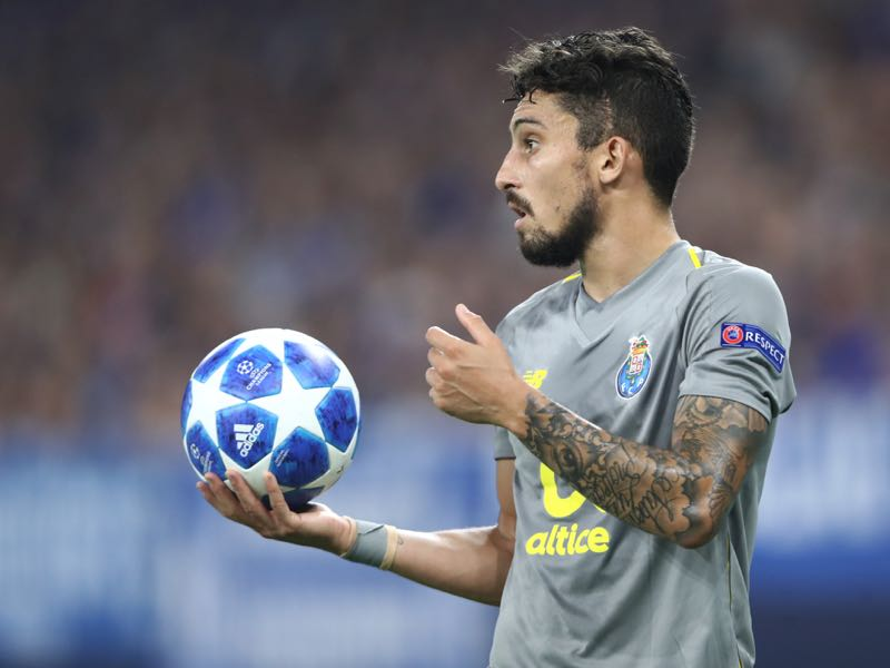 Alex Telles of Porto holds the ball during the Group D match of the UEFA Champions League between FC Schalke 04 and FC Porto at Veltins-Arena on September 18, 2018 in Gelsenkirchen, Germany. (Photo by Alex Grimm/Bongarts/Getty Images)
