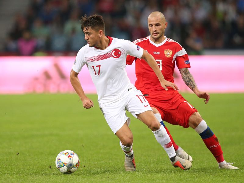 Russia's defender Fedor Kudryashov (R) vies for the ball with Turkey's forward Cengiz Under (L) during the UEFA Nations League football match between Russia and Turkey at the Fisht Stadium in Sochi, on October 14, 2018. (Photo by STR / AFP) (Photo credit should read STR/AFP/Getty Images)