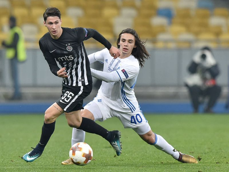 Dynamo's Mykola Shaparenko (R) vies with Partizan's Danilo Pantic (L) during the UEFA Europa League group stage football match between Dynamo Kyiv and FK Partizan in Kiev on December 7, 2017. (GENYA SAVILOV/AFP/Getty Images)