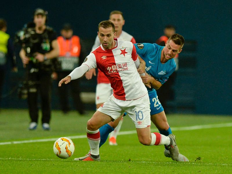 Slavia Prague's Czech midfielder Josef Husbauer (L) and Zenit St. Petersburg's Slovak midfielder Robert Mak vie for the ball during the UEFA Europa League group C football match between FC Zenit and SK Slavia Prague in Saint Petersburg on October 4, 2018. (Photo by OLGA MALTSEVA / AFP)