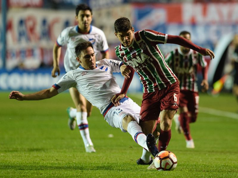 Ayrton Lucas - Uruguay's Nacional midfielder Paulo Matias Zunino (L) and Brazil's Fluminense Ayrton Lucas vie for the ball, during their Copa Sudamericana second-leg quarter final football match, at the Parque Central stadium in Montevideo on October 31, 2018. (Photo by Miguel ROJO / AFP)