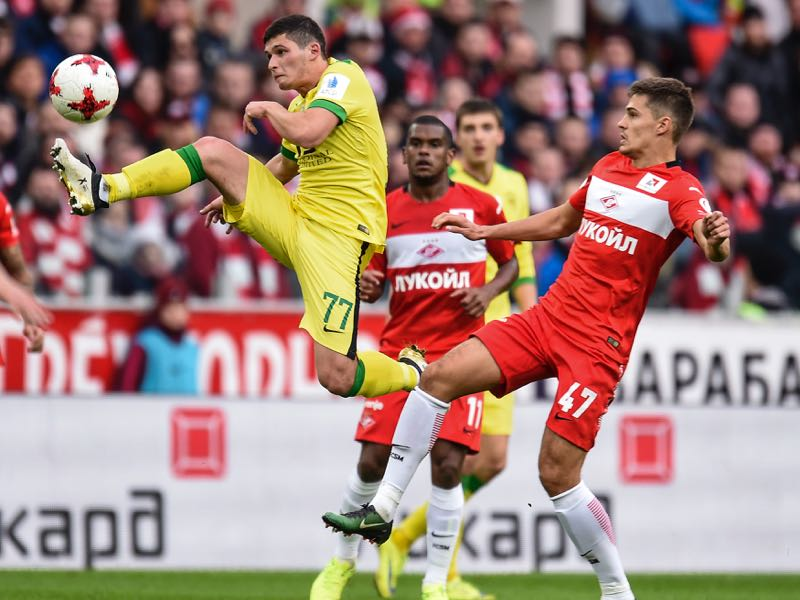 Roman Zobnin (R) of FC Spartak Moscow is challenged by Ayaz Guliyev of FC Anji Makhachkala during the Russian Premier League match between FC Spartak Moscow v FC Anji Makhachkala at Otkrytie Arena Stadium on March 12, 2016 in Moscow, Russia. (Photo by Epsilon/Getty Images)