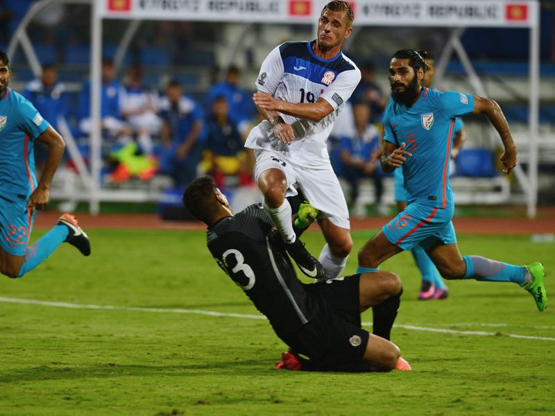 Vitalij Lux Kyrgystan's Vitalij Lux (2R) clashes with India's goalkeeper Gurpreet Singh Sandhu during the AFC Asian Cup qualifier football match between India and Kyrgyzstan in Bangalore (MANJUNATH KIRAN/AFP/Getty Images)