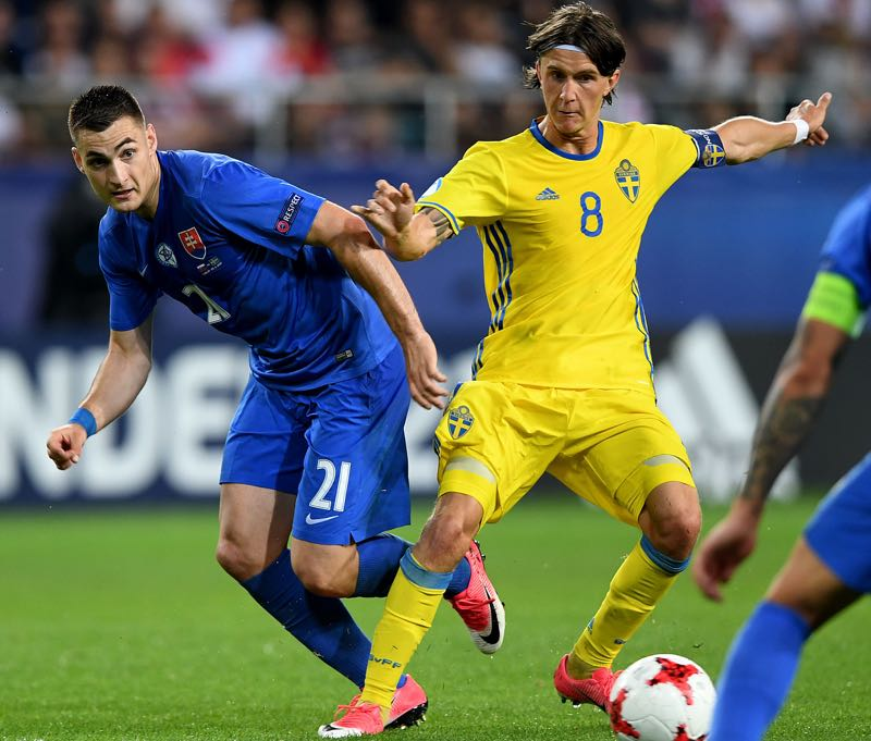 Kristoffer Olsson Slovakia's midfielder Matus Bero and Sweden's midfielder Kristoffer Olsson vie for the ball during the UEFA U-21 European Championship roup A football match Slovakia v Sweden in Lublin, Poland on June 22, 2017. (JANEK SKARZYNSKI/AFP/Getty Images)