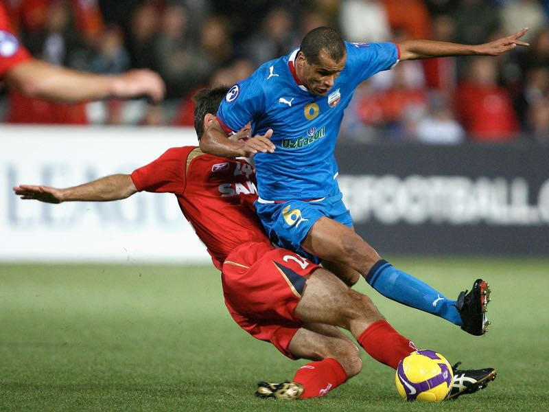 Paul Reid of United crashes in to Rivaldo of Bunyodkor during the AFC Champions League semi-final first leg match between Adelaide United and Bunyodkor at Hindmarsh Stadium on October 8, 2008 in Adelaide, Australia. (Photo by Simon Cross/Getty Images)